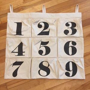 Land of Nod canvas hanging number storage